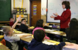 Dupont Elementary School fourth grade teacher Helen Brady, cq, asks her students Monday Dec. 4,...