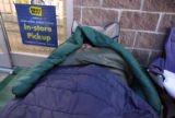 Shawn Brower (cq), 20, sleeps  early Thursday morning November 16,2006 in front of Best Buy at...