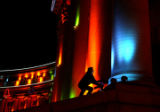 Gina Chavez (cq) adjusts a colored spotlight on the Denver City and County Building during a test...