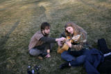 Jeremy Carlise  (l), from Denver, teaches a new guitar chord to Eleanor Evans , also from Denver...