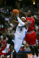 The Denver Nuggets Carmelo Anthony (#15) drives hard to the basket for a bucket on the Chicago...