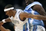 The Denver Nuggets J.R. Smith (#1, left) celebrates with a teammate Reggie Evans (#30, right)...