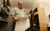 John Mills, cq,  pulls clean ballots so they can be duplicated, as ballot counting continues,...