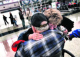 Anita Gilstrap  (r), from Thornton, cries and hugs her father Bill Capps , from North Carolina, as...