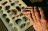 Photo of the hands of Duane Harms, with polished agates, who was the driver of a school bus that...