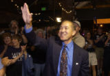 (DENVER, Colorado. August 10, 2004) Mike Miles waves to his supporters as her arrives at the Mike...