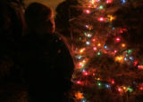 Harley Chrismer (cq), 11, was given the duty of lighting the Christmas tree at the El Pueblo...