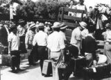 Male internships being loaded onto a truck at the Grenada-Amache Japanese Internment Camp.   ...