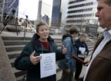 Sister Ardeth Platte  (l) talks with passer-by Bill Farr , from Lakewood on November 16, 2006,...