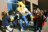 Rocky, the Nuggets mascot, leads a group of kindergartners from Barrett Elementary School into the...