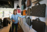 Sheri Murphy (cq), from Colorado Springs, does some shopping in Composition, a modern life style...