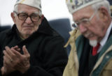 Pearl Harbor survivor Francis Jampetero (cq) (l), 88, gets emotional while the names of the men...