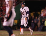 [JPM601] In the third quarter, Denver Broncos quarterback Jake Plummer (16) walks off the field...