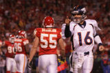 [JPM874] In the third quarter, Denver Broncos quarterback Jake Plummer (16) points at tight end...