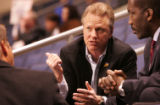 [JPM011] Colorado 14ers co-owner Tim Weins, center, talks to NBA Development League president Phil...