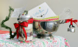 Jen Miller (Cq), has created these gift baskets.  November 30, 2006.  Items for the cook who...
