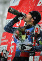 U.S. skier Bode Miller takes a swig of champagne on the podium after winningd the Visa Birds of...