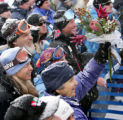 Bode Miller's grandmother holds a bouquet of flowers given to her by Bodie Miller at the bottom of...