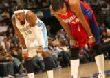 MJM182  Carmelo Anthony of the Denver Nuggets, left, rests along Shaun Livingston of  the Los...