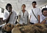 (NYT52) HAVANA, Cuba -- Dec. 7, 2006 -- CUBA-MEDICAL-SCHOOL -- Nancy Gonzales, center, uses a...