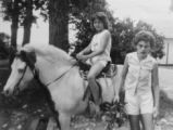 Historical photo of Pam Heimbuck, 8, left, on her horse, and Kathy Heimbuck, 11, right, about one...