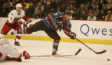 [JPM150] Colorado Avalanche center Pierre Turgeon (87) fires a shot against the Carolina...