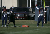BG1529  Denver Broncos Jake Plummer, left, and Jay Cutler practice, right, practice next to each...