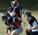 Jay Cutler #6  takes a snap from #66 Tom Nalen  as the new starting quarterback practiced today at...
