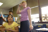 (Denver, Colo., August 25, 2004) Fifth grade teacher Jessica Gillesby talks with her class while...