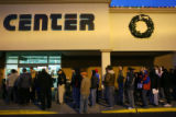 MJM044    Hundreds of people wait in line outside Micro Center in Denver for special sale prices...