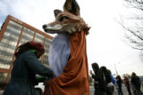 Kris Candour, cq, of Boulder helps pin the costume of a skinned fox together for Donnie...