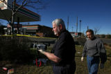 Aurora crime scene investigators collect evidence at a 7-11 Sunday morning December 10, 2006,...