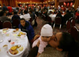 MJM156 Naomi Hernandez (cq), right, kisses her niece, Natalie Urbina, 6 months during the annual...