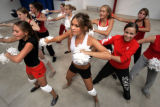 (AURORA, Colo., Aug. 25, 2004)  Regis High School sophomore Samantha Straight (center), 15,...