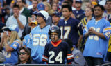 In the second quarter, young Denver Broncos fan Anil Pharani (cq, center), 12, of San Diego...