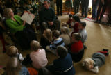 (DLM1470) -  Chloe Kuhn, 22 months, lays down behind the other kids gathered to listen to Colorado...
