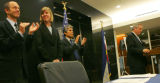 (from left) Tom Plant (cq), from the Governor Energy Office, applauds as Heidi VanGenderen (cq) is...