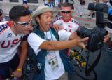 (ATHENS, GREEECE, AUGUST 11, 2004)   Houston Chronicle photojournalist, Kevin Fujii, center, takes...