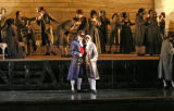 Oscar (soprano Heidi Stober of Dorchester, MA) and Captain Anckarström (baritone Chen-Ye Yuan)in...