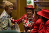 DLM9127  Laughs are bipartisan as Rep. Cherilyn Peniston, D-Westminster, far left, visits with...