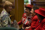 DLM9132  Laughs are bipartisan as Rep. Cherilyn Peniston, D-Westminster, far left, visits with...