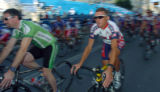 (ATHENS, GREEECE, AUGUST 11, 2004)    USA Road Cyclist, Tyler Hamilton, right, takes off during a...