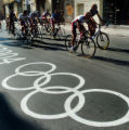 (ATHENS, GREEECE, AUGUST 11, 2004)  Olympic riders pass an olympic sign painted on Saturday's...