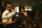 42 year-old Jorge Mora (cq) and stepmother 41 year-old Maria Gonzales (cq) collect the security...