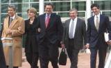 Joe Nacchio (cq) ,center,with his wife Anne Esker (cq)  and members of his defense team, leaves...