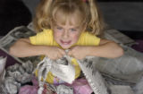 (DENVER, CO., 8/11/04) --Sheridan Snapp, who'll be 6 years old on August 18, tears up some...