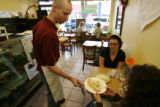Brad Birky co-owns the cafe with his wife Libby, serves up food to customers at their SAME Cafe,...