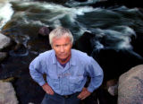 (VAIL Colo., June 23, 2004) Long time Vail resident Chuck Ogilby stands by Gore Creek, which runs...
