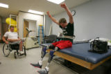 Tyler Carron (cq), pumps his fists in the air after walking at Spalding Rehabilitation Hospital in...