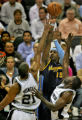 Denver Nuggets' #15, Carmelo Anthony, center, gets double teamed by San Antonio Spurs' #21, Tim...